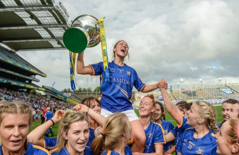 Samantha Lambert and her Tipperary team-mates celebrates with the cup following the intermediate cup win against Tyrone. Photograph: Cody Glenn/Sportsfile