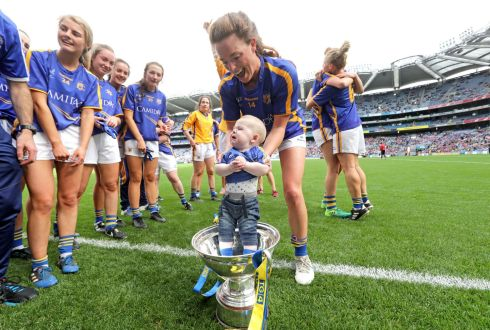 Tipperary's Gillian O'Brien celebrates with her six-month-old nephew Harry Hayes. Photograph: Morgan Treacy/Inpho