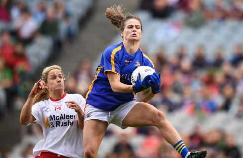 Maria Curley of Tipperary in action against Gemma Begley of Tyrone during intermediate final. Photograph: Cody Glenn/Sportsfile