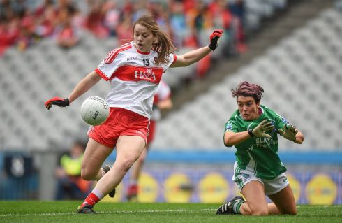 Maria Connolly of Fermanagh attempts to blaock Annie Crozier of Derry during the junior final. Photograph: Cody Glenn/Sportsfile