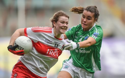 Derry's Annie Crozier is challenged by  Naomi McManus of Fermanagh during the junior final. Photograph: Cody Glenn/Sportsfile