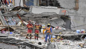 Spanish and Mexican rescue workers continue to search for survivors in Mexico City on Sunday. Photograph: AFP/Getty Images