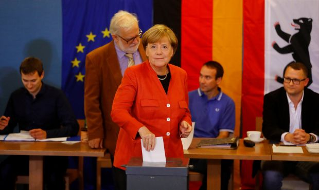 German chancellor and leader of the Christian Democratic Union Angela Merkel votes in the general election. Photograph: Kai Pfaffenbach/Reuters
