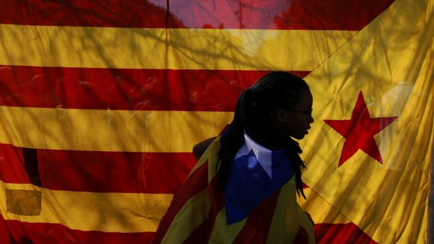 A woman wearing an Estelada (Catalan separatist flag) in Barcelona. Photograph: Susana Vera/Reuters