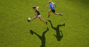 Grace Kelly of Mayo is tracked by Carla Rowe of Dublin. Photograph: Sportsfile