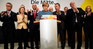 German chancellor and CDU party leader Angela Merkel addresses supporters. Photograph: Odd Andersen/AFP/Getty Images