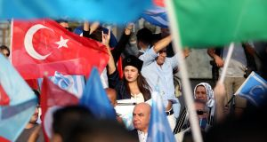 Turkish protestors hold Turkish and Turkmen flags as they shout slogans against Kirkuk for taking part in the Kurdish referendum during a demonstration in Istanbul, Turkey on Sunday. Photograph: Erdem Sahin/EPA