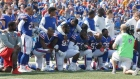 NFL players defy Trump by kneeling for national anthem