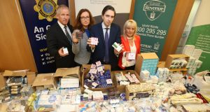 Detective Superintendent Ashley O'Sullivan; Dr Lorraine Nolan, chief executive of the Health Products Regulatory Authority (HPRA); Heath Minister Simon Harris and Esther Keating from the Revenue's Customs Service pose with illegal medicines seized. Photograph: Niall Carson /PA Wire