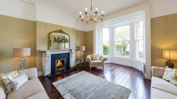 The drawingroom at 11 Spencer Villas has a wide and deep bay window with working shutters, a marble fireplace and original plasterwork