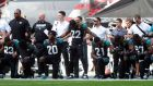 NFL players deliver a defiant message to US president Donald Trump at Wembley Stadium, London, on Sunday. Photograph: Simon Cooper/PA Wire