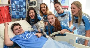 Rory Whelan (14) from Fethard-on-Sea, Co Wexford,   with Dublin All-Ireland winning players Lyndsey Davey, Rebecca McDonnell, Lauren Magee, Hannah O'Neill and Emily Flanagan during the champions' visit to Temple Street Children's Hospital in Dublin. Photograph: Cody Glenn/Sportsfile