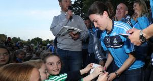 Sinéad Aherne signs autographs for young fans at Malahide homecoming. Photograph ©INPHO/Oisin Keniry