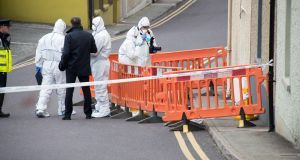 State Pathologist Marie Cassidy and Garda technical experts examine the scene in Skibbereen where a man's body was found. Photograph: Provision
