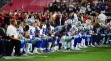 Dallas Cowboys booed for kneeling before US national anthem