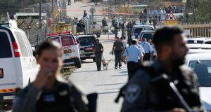 Israeli security forces and emergency services gather at the scene of a shooting attack at the entrance to the Jewish settlement of Har Adar. Photograph: Abit Sultan/EPA