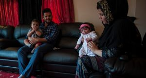 Jabar Azizi and Surat Ahmed with their children at home in Carrick-on-Shannon. Aziz was among the nearly 100 Kurdish refugees who were resettled in town. Photograph: Paulo Nunes dos Santos/The New York Times