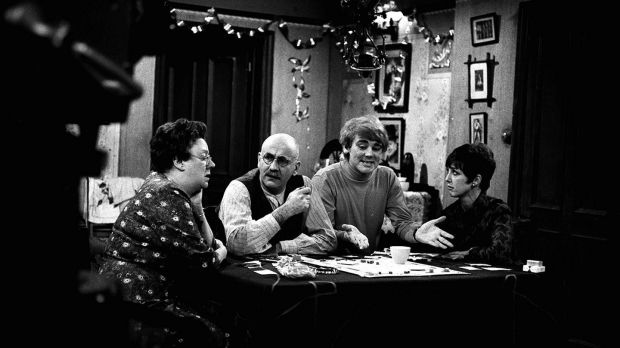 Left to right: Dandy Nichols, Warren Mitchell, Tony Booth and Una Stubbs on the set of the BBC comedy Till Death Us Do Part. Photograph. PA Wire