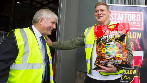 Andy Maher, managing director of Stafford Fuels, and Ireland and Leinster rugby star Tadhg Furlong at the official opening of their €3 million plant in New Ross, Co Wexford. Photograph: Mary Browne