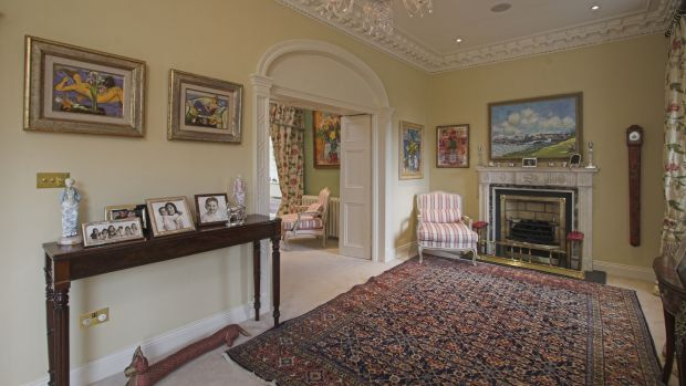 Reception rooms at the front of the house flow into one another: the front porch opens into a reception hall which opens through an arch into the drawingroom.