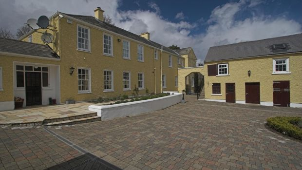 The neat courtyard is ringed by one- and two-storey stone outbuildings that include 10 loose boxes.