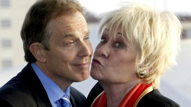 Former prime minister Tony Blair accepts a kiss from Dawn. Photograph: Reuters
