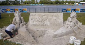 Dean Arscott of Team Sandtastic creates sand sculpture in the fan viewing area at  the  World Rowing Championships at Nathan Benderson Park in Sarasota, Florida. Photograph: Erik S Lesser/EPA