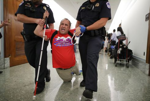 TRUMPCARE: Police drag a blind protester out of a US Senate hearing on the Graham-Cassidy healthcare Bill, with which the Republican Party hopes to replace Obamacare.  Photograph: Chip Somodevilla/Getty
