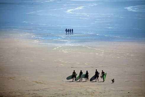 CROWD SURFING: Walkers and surfers on Inch Strand, on the Dingle Peninsula, in Co Kerry. Photograph: Valerie O'Sullivan