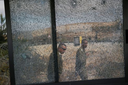 ISRAEL ATTACK: Israeli soldiers outside a security booth damaged when a Palestinian gunman killed three Israeli guards and wounded a fourth in a Jewish settlement in the West Bank. Photograph: Ammar Awad/Reuters