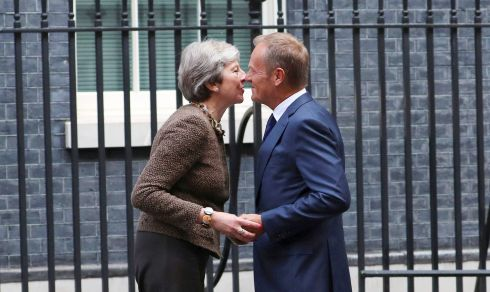 EUROPEAN UNION: Theresa May, the UK prime minister, greets Donald Tusk, president of the European Council, at Downing Street. Photograph: Hannah McKay/Reuters