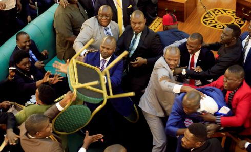 PARLIAMENTARY TUSSLE: Ugandan lawmakers fight in parliament ahead of a debate to extend the president's rule. Photograph: James Akena/Reuters