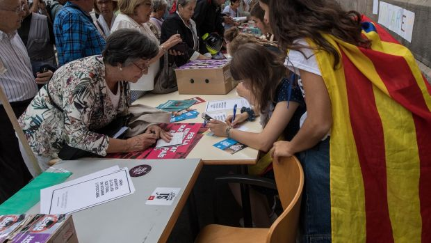University students help citizens to identify where they can vote in the Catalan referendum on October 1st, which has been deemed illegal by the Spanish government in Madrid. Photograph: David Ramos/Getty Images