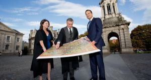 Taoiseach Leo Varadkar looks at a map of Dublin from 1610  with  Trinity's registrar Prof Paula Murphy and  provost Dr Patrick Prendergast at an event to celebrate 425 years since TCD's founding. Photograph: Tom Honan