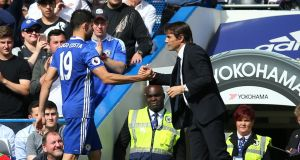 Diego Costa and Antonio Conte shake hands during their time at Chelsea. The pair will come face to face again on Wednesday evening after the striker's controversial exit from the club. Photo: Catherine Ivill - AMA/Getty Images