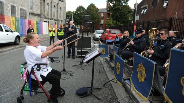 Mary Reilly conducts the Garda band during the Playful Street event held on Sherrif Street. Photograph: Aidan Crawley