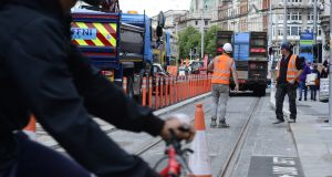 Workmen prepare Westmoreland Street for Luas line work.  Photograph: Cyril Byrne