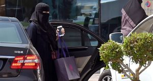 A Saudi woman outside a mall in the Saudi capital Riyadh a day after the government lifted a ban on women driving. Photograph: Fayez Nureldine/AFP/Getty Images
