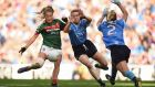 Mayo's  Sarah Rowe  is challenged by Dublin's  Lauren Magee and Martha Byrne. The speed, the skill, the passion of the game thrilled the 46,286 fans in Croke Park.  Photograph:  Cody Glenn/Sportsfile