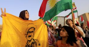 Syrian Kurds wave the Kurdish flag, in the northeastern Syrian city of Qamishli during a gathering in support of the independence referendum in Iraq's autonomous northern Kurdish region. Photograph: Delil Souleiman/AFP/Getty Images