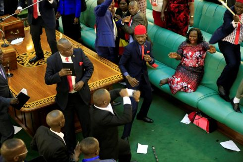 POLITICAL SCRAP: Ugandan opposition politicians fight with plain-clothes security personnel in the Ugandan parliament, in Kampala. Photograph: James Akena/Reuters