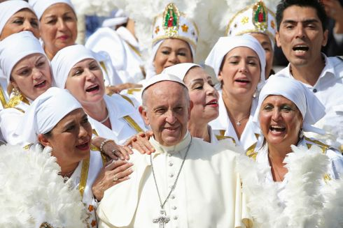 PAPAL AUDIENCE: Pope Francis poses with a group of Mexican faithful in St Peter's Square, at the Vatican. Photograph: Alessandro Bianchi/Reuters