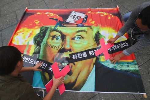 KOREAN PROTEST: Anti-war activists work on a banner during an anti-Trump rally near the US embassy in Seoul, South Korea. Photograph: Jung Yeon-je/AFP/Getty Images