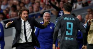 Chelsea's Alvaro Morata celebrates scoring their first goal with manager Antonio Conte. Photograph: Paul Hanna/Reuters