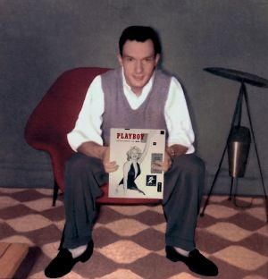 Hugh Hefner with the first edition of Playboy magazine in 1953. Photograph: Playboy/PA Wire