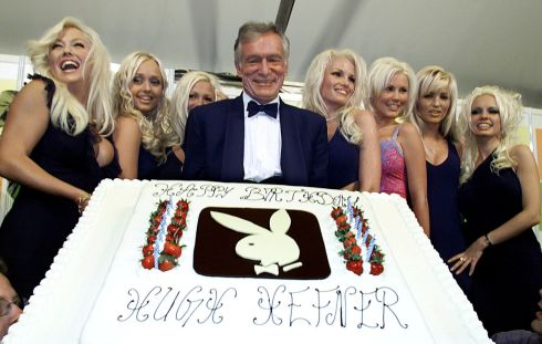May 12th, 2001: Hugh Hefner displays a giant birthday cake to celebrate his 75th birthday as seven playmates look on in Cannes, France. Photograph: REUTERS