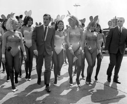 June 25th, 1966: Playboy bunnies with Hefner. Photograph: PA Wire