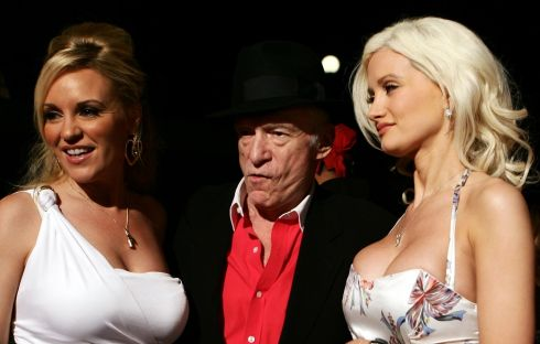 June 2nd, 2006: Hugh Hefner arrives at a party with girlfriends Bridget Marquardt (L) and Holly Madison (R) to celebrate his 80th birthday at Villa Miani in Rome.  Photograph: AFP/Getty Images