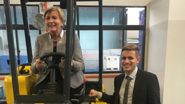 Tánaiste Frances Fitzgerald in the driver's seat of a Combilift multi-directional forklift, with Philip Condell of the Monaghan-based company. Photograph Clifford Coonan.