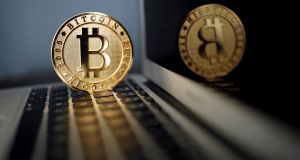 A Bitcoin (virtual currency) coin is seen in an illustration picture taken at La Maison du Bitcoin in Paris. Photograph: Benoit Tessier/Reuters